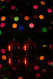 Red candles with christmas bokeh. Red candles with christmas coloured bokeh Stock Photo