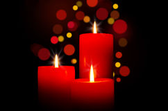 Red candles for Christmas. Red burning candles for Christmas Stock Photography