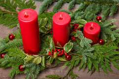 Red candles in Christmas evergreen arrangement Royalty Free Stock Images