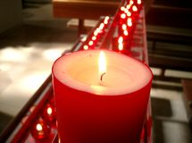 Red candles in a church royalty free stock photography