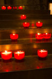 Red candles in church. Red candles burning in old church Stock Photo