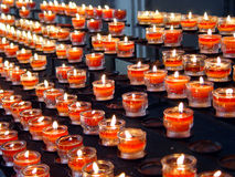 Red candles in a church Stock Photography