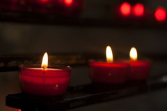 Red candles in a church Stock Images