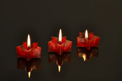 Red candles on dark background Stock Image