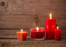 Red candles on dark wooden background Royalty Free Stock Image