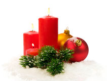 Red candles and fir branches and Christmas balls in snow Stock Photography