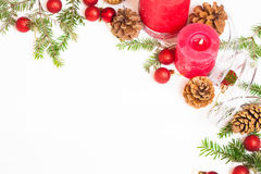 Red candles, fir branches and Christmas decorations Royalty Free Stock Image