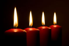 Red candles with flames Royalty Free Stock Photography