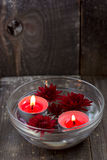 Red candles and flowers in a bowl royalty free stock photo