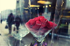 Red candles in the form of hearts in the glass in the window Royalty Free Stock Images