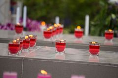 Focused red candles in the glasses royalty free stock images