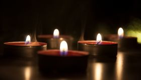 Red candles glowing in the night royalty free stock photo