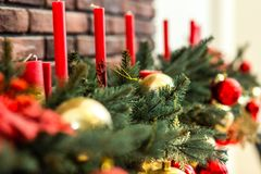 Red candles and golden christmas ornaments looking amazing on the christmas tree royalty free stock photography