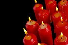 Red candles. Group of red candles with copyspace (black bacground Royalty Free Stock Photos