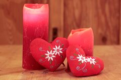 Red candles and hearts Royalty Free Stock Image