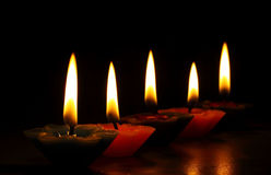 Red candles light. In the dark Stock Photography