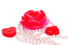Red candles and necklace Royalty Free Stock Photo