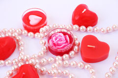 Red candles and necklace Stock Photography