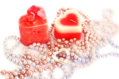 Red candles and necklaces royalty free stock image