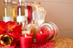 Red candles and oils still life Stock Photo