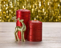 Red candles and rain deer Royalty Free Stock Photo
