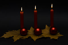Red candles and red balls. Royalty Free Stock Photo