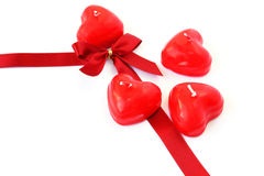 Red candles and ribbon Royalty Free Stock Images