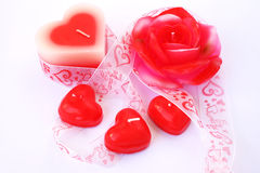 Red candles and ribbon Stock Image