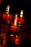 Red candles for romantic evening. Red candles in a jars Royalty Free Stock Image