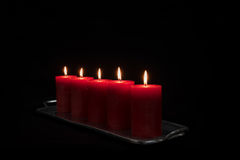 Red candles in a row burning Stock Photos