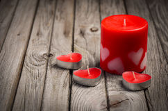 Red candles on rustic wooden background. Valentine's day card. Royalty Free Stock Photography