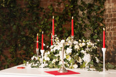 Red candles on table with flame. Romantic decoration. Stock Photography