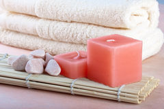 Red candles and towel with peach background. Red candles and towel with peach color background Stock Photography