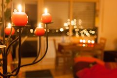 Red candles lighting a house in Christmas time stock photos