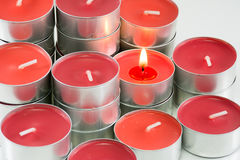 Red candles on white background.  Stock Photo