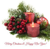 Red Candles With Berries And Conifer Branches Royalty Free Stock Image