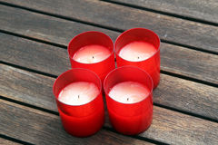 Red candles on wooden background Royalty Free Stock Photo