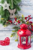 Red candlestick with a candle inside and a branch of a Christmas tree. Theme of the New Year and Christmas Stock Photos
