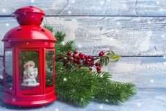 Red candlestick with a candle inside and a branch of a Christmas tree. Theme of the New Year and Christmas Royalty Free Stock Images