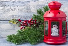 Red candlestick with a candle inside and a branch of a Christmas tree. Theme of the New Year and Christmas Royalty Free Stock Image
