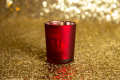Red candlestick. On the gold background Stock Photos
