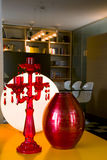 Red candlesticks and red vase Stock Images