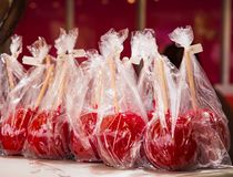 Red candy apples in plastic foil Royalty Free Stock Image