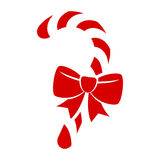 Red candy cane with bow icon. Stock Images