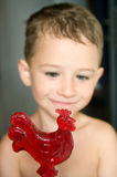 Red candy in hands of a kid Stock Photo