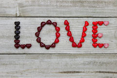 Red candy hearts spell LOVE Stock Photos
