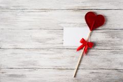 Red Candy Lollipop And Blank Note On Grey Rustic Wood Background. Valentines Theme Royalty Free Stock Image