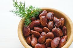Red canned beans. With fresh dill in wooden bowl over white background, copy space Royalty Free Stock Photo