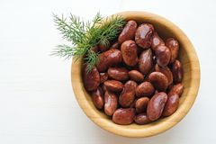 Red canned beans. With fresh dill in wooden bowl over white background, copy space Royalty Free Stock Photography