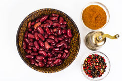 Red canned beans in wooden bowl on white background. Studio Photo Stock Photography
